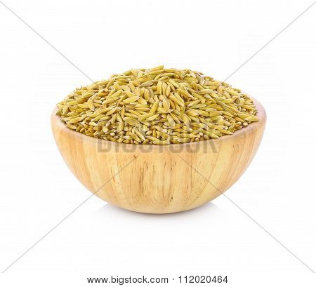 Paddy Grains In Wooden Bowl Isolated On White Background.