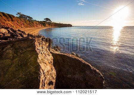 Seascape Of Sunset Overlooking House On A Cliff