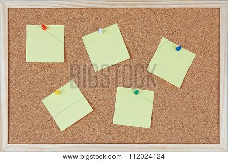 Six Yellow Sticky Notes With Pins Sticked On Corkboard