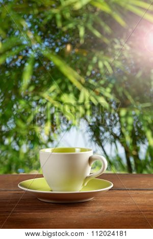a cup of coffee or tea on garden background