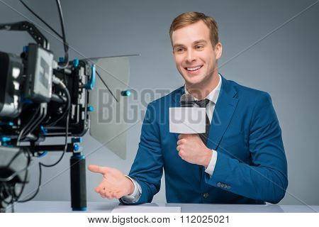 Newsman during broadcasting process
