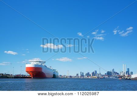 Large Cargo Ship In Yarra River With Melbourne Cbd Skyline In The Background