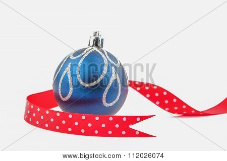 Christmas Bauble With Red Dotted Ribbon Isolated On White.