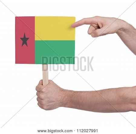 Hand Holding Small Card - Flag Of Guinea Bissau