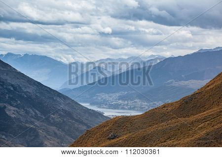 Beautiful Orange Hills With Queenstown In The Distance, Otago, New Zealand