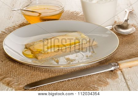 Crisp Bread With Sweet Honey On A Plate