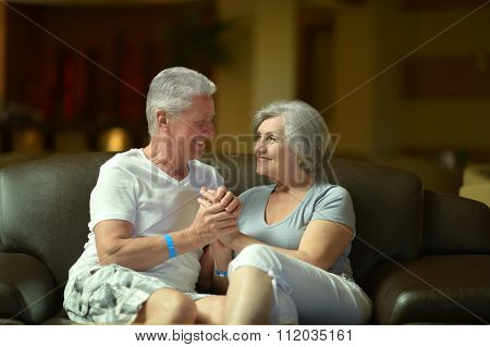 beautiful elderly couple on sofa