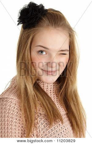 Playful Young Girl Winks On White Background