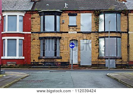A Street Of Boarded Up Derelict Houses Awaiting Regemeration In Liverpool Uk