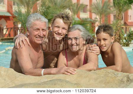 Happy Elderly couple with grandsons