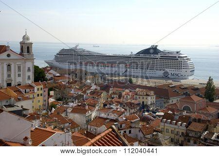 Lisbon, Portugal - September 2015: Huge vessel anchoring right in front of Lisbon's historic part, the Alfama, in September 2015