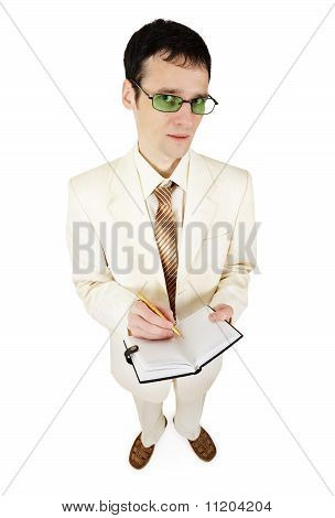 Young Businessman In Light Suit Writes In Notebook