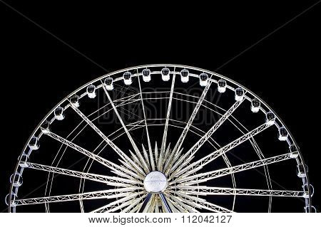 LIVERPOOL 16TH DECEMBER 2015. Large ferris wheel illuminated in motion at night at Albert Dock Liver