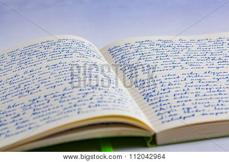 Extreme Closeup Of Open Notebook With Handwritten  Lorem Ipsum Text With Shallow Focus