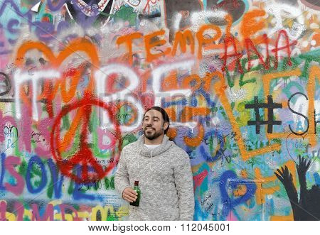 Man Standing In Front Of Colorful Painted Wall
