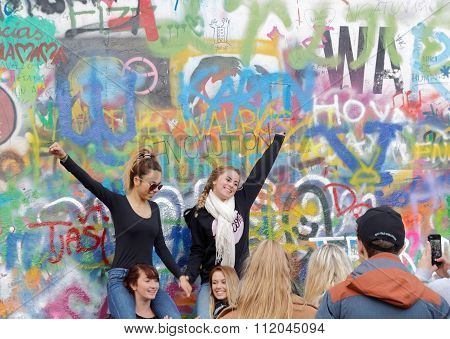 Two Happy Woman In Colorful Painted Wall