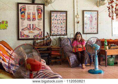 KO CHANG - THAILAND - DEC 19, 2015: Unidentified local woman employee Thai massage salon. The island is part of marine national Park Mu Ko Chang. Island population of 5356 people living in 8 villages.