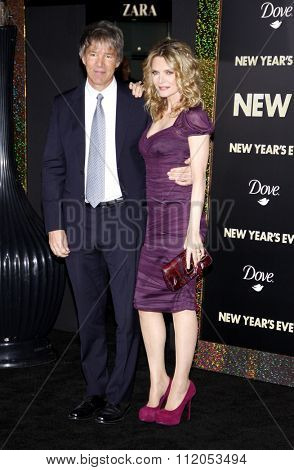 HOLLYWOOD, CALIFORNIA - December 5, 2011. David E. Kelley and Michelle Pfeiffer at the Los Angeles premiere of