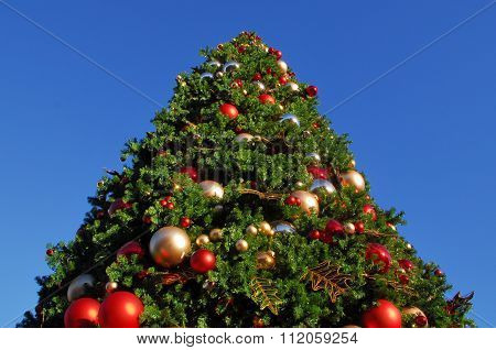 Big Christmas tree decorated with baubles and ornaments