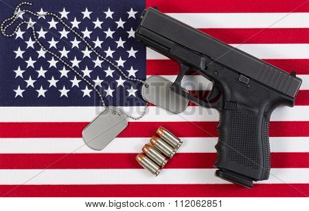 Close Up Of Military Equipment On Usa Flag