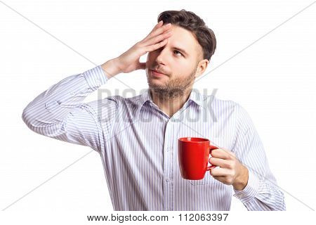 Handsome Businessman With A Headache Holding Red Cup