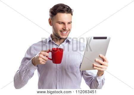 Handsome Smiling Businessman Holding Red Cup And Reads Computer