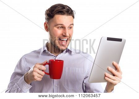 Handsome Surprised Businessman Holding Red Cup And Reads Compute