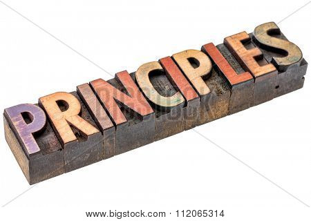 principles word abstract - an isolated banner in vintage letterpress wood type blocks stained by color inks