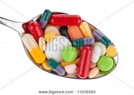 Tablets and medicines on spoon