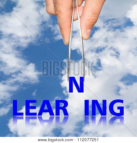 Hand With  Forceps And  Word Learning