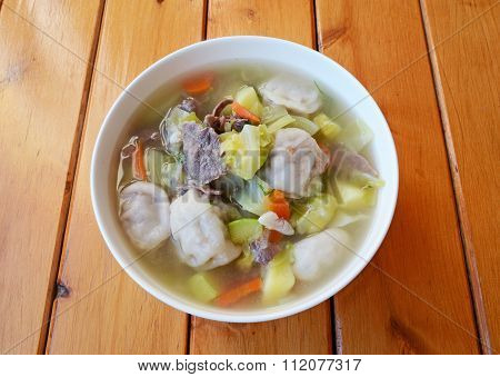 Soup with dumplings, vegetables and meat slices