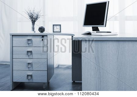monitor on desk in a modern office