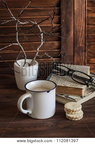 Coffee, Biscuits And A Stack Of Old Books On Brown Wooden Table. The Concept Of Education And Traini