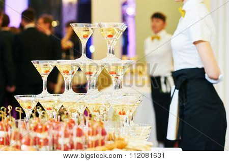 Champagne pyramid with waitress on event, party or wedding banquet reception