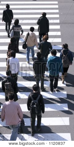 Group Of People Crossing The Street