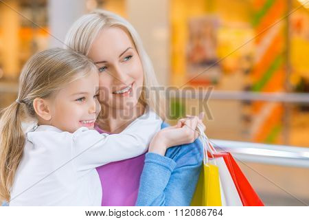 Mother and daughter shopping in mall
