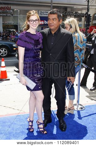 HOLLYWOOD, CALIFORNIA - April 10, 2011. Anne Hathaway and George Lopez at the Los Angeles premiere of