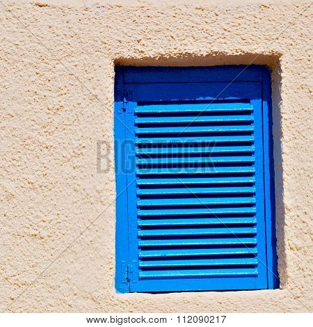 In Santorini Europe Greece  Old Architecture And Blue    Venetian Blind Yellow Wall