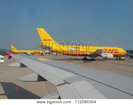 Dhl Aircrafts Parked At The Airport