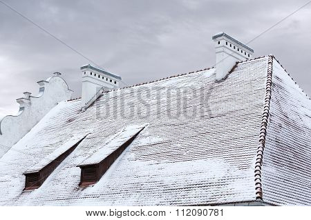 Snow Covered Old House Roof
