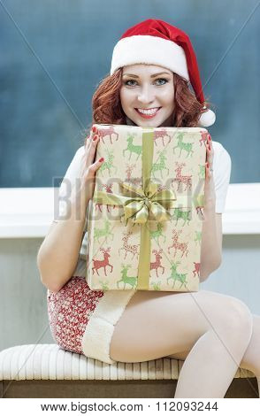 Christmas, New Year, X-mas Concepts And Celebrations. Young Caucasian Santa Helper Girl With Big Pre