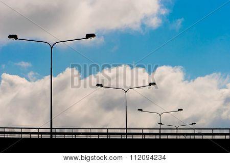 Lighting Lanterns On The Bridge