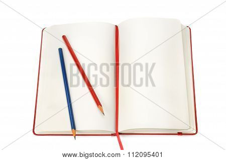 Notepad And Pencils Isolated On White Background
