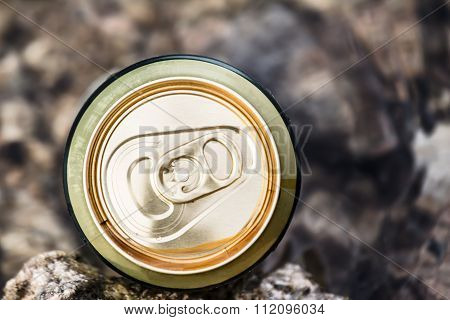 Unopened Container Of Beer Is Cooled In The River