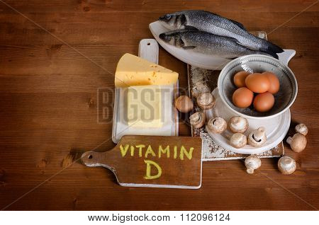 Foods Containing Vitamin D On Wooden Background.