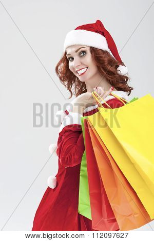 New Year And Christmas Concept And Ideas. Closeup Portrait Of Smiling Caucasian Red-haired Santa Gir