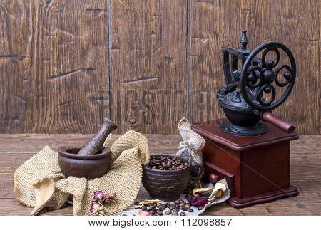 Vintage A Coffee Grinder, A Cup, A Mortar  And Coffee Beans On Old  Homespun Canvas