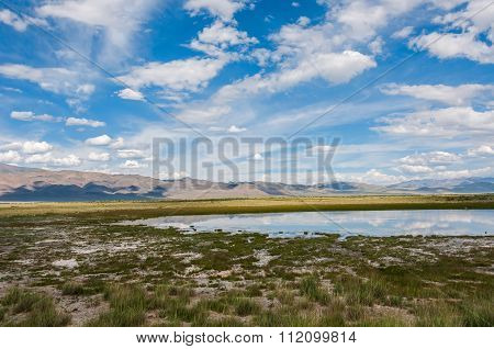 Lake Steppe Sky Mountains Clouds