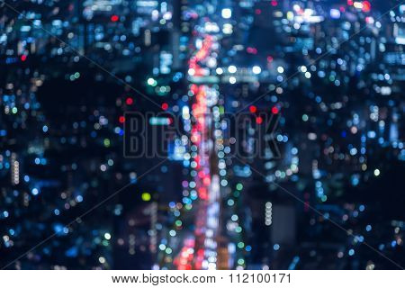 Blurred bokeh lights city road during busy hour at night