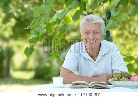 Older man with book